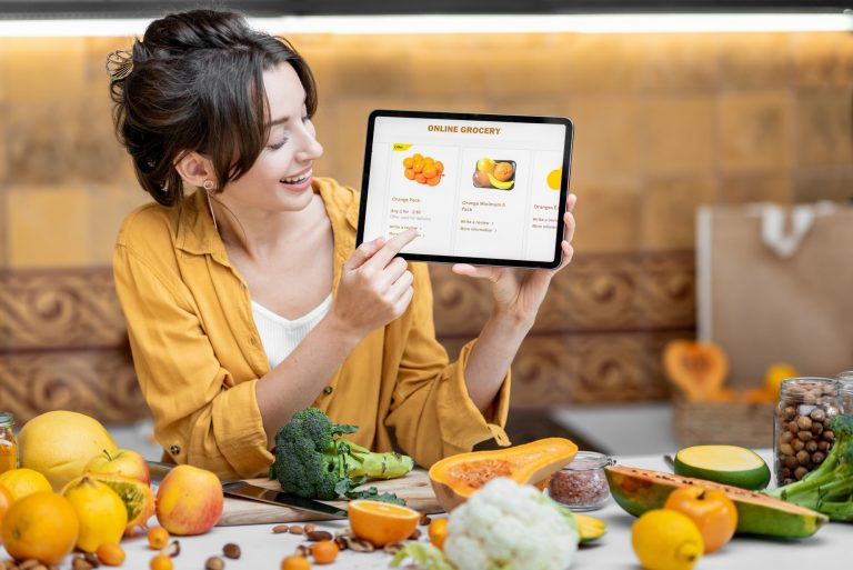 Woman shopping online using digital tablet
